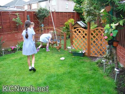 children and chickens in garden